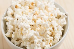 Try to get a microwave popcorn for that nice experience at home