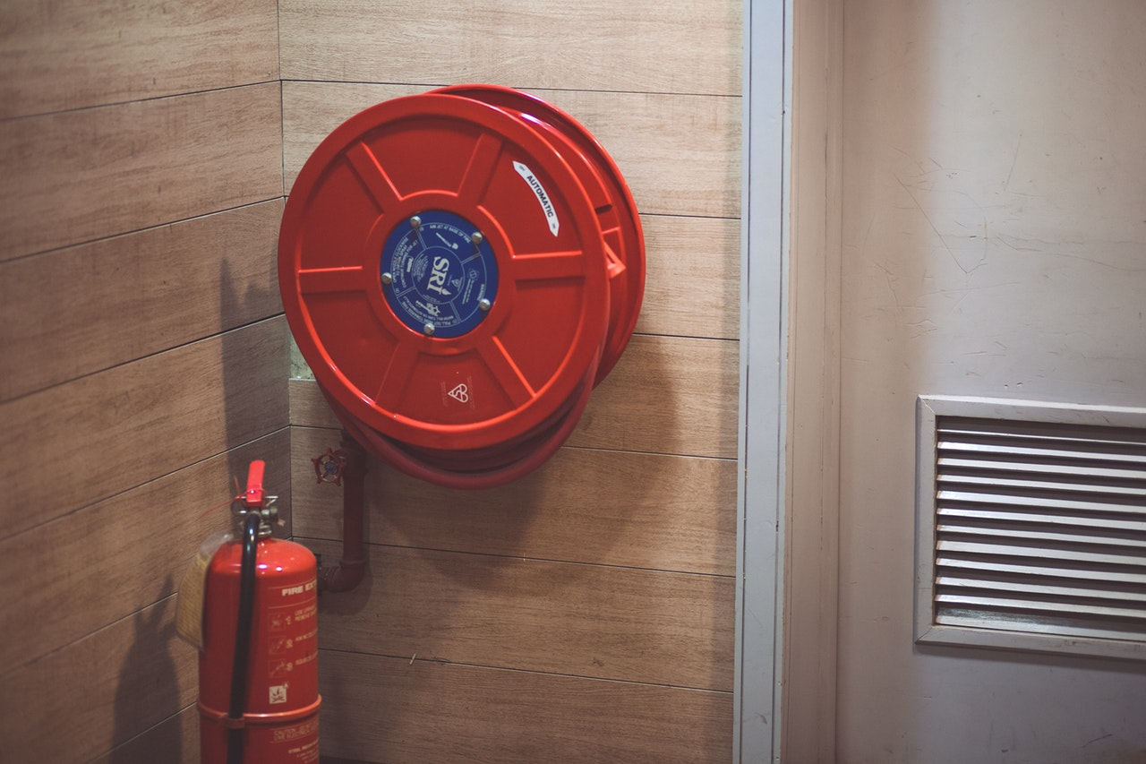 https://www.pexels.com/photo/red-fire-extinguisher-beside-hose-reel-inside-the-room-189474/